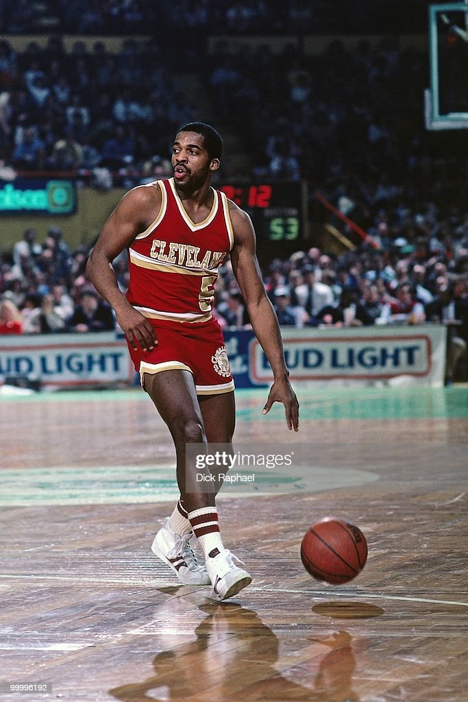 John Bagley #5 of the Cleveland Cavaliers moves the ball up court against the Boston Celtics during a game played in 1983 at the Boston Garden in Boston, Massachusetts.