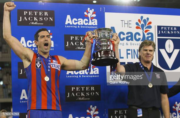 John Baird and Gary Ayres of Port Melbourne celebrate with the trophy after winning the VFL Grand Final match between Port Melbourne and Williamstown...