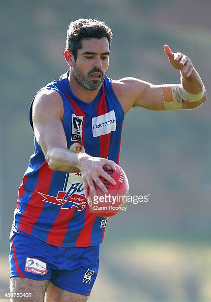 John Baird of Port Melbourne kicks during the VFL Semi Final match between Port Melbourne and Sandringham at North Port Oval on September 6 2014 in...