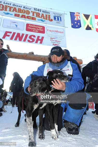 John Baker celebrates with his lead dogs after winning the Iditarod Trail Sled Dog Race Tuesday morning on March 15 in Nome Alaska