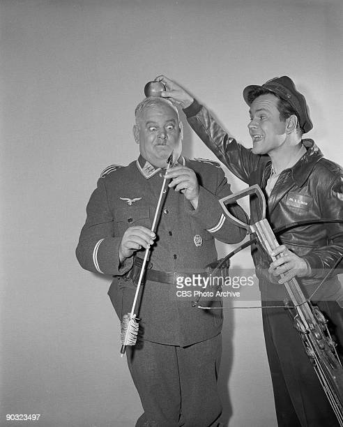 HEROES John Banner as Sgt Hans Georg Schultz left and Bob Crane as Col Robert E Hogan in The Assasin an episode from the CBS television comedy series...