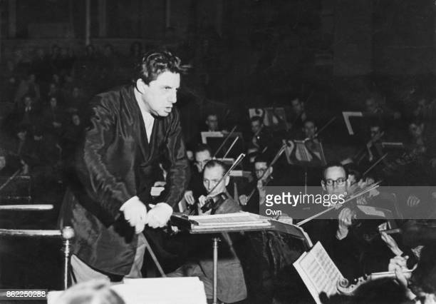 John Barbirolli conducts the BBC Symphony Orchestra at the BBC headquarters in London, UK, 13th February 1944.