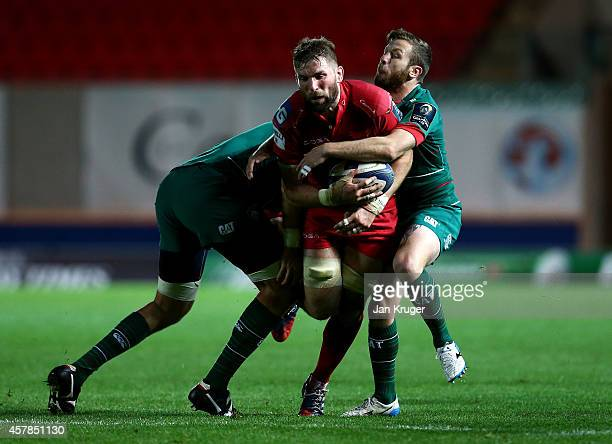 John Barclay of Scarlets crashes through the tackle of David Mele of Leicester Tigers during the European Rugby Champions Cup match between Scarlets...