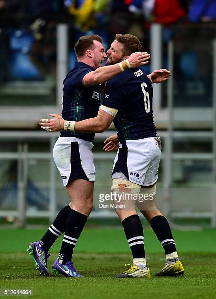 John Barclay of Scotland celebrates scoring his side's first try with Stuart Hogg of Scotland during the RBS Six Nations match between Italy and...