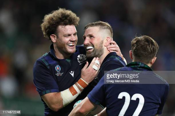 John Barclay of Scotland celebrates with team mate Duncan Taylor after scoring his sides eighth try during the Rugby World Cup 2019 Group A game...