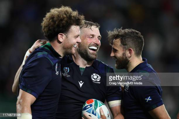 John Barclay of Scotland celebrates with team mates Duncan Taylor and Henry Pyrgos after scoring his sides eighth try during the Rugby World Cup 2019...