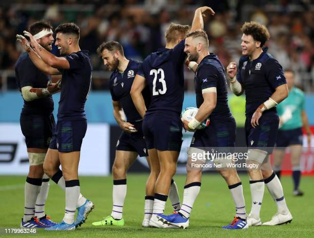 John Barclay of Scotland celebrates with teammates after scoring his team's eighth try during the Rugby World Cup 2019 Group A game between Scotland...