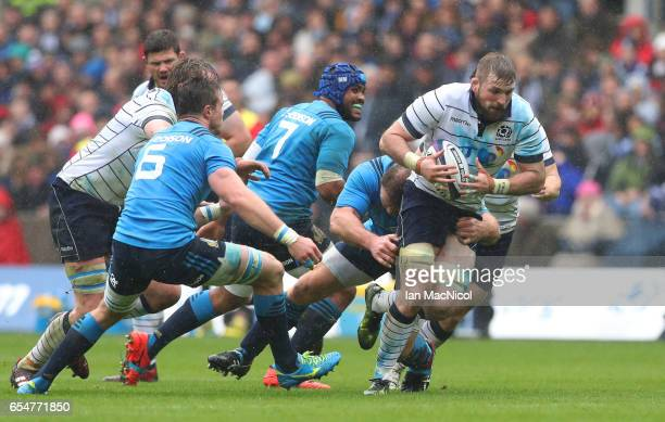 John Barclay of Scotland charges upfield during the RBS Six Nations match between Scotland and Italy at Murrayfield Stadium on March 18 2017 in...