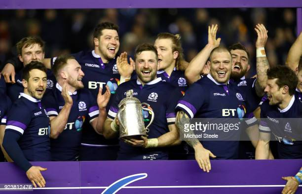 John Barclay of Scotland holds aloft the Calcutta Cup and leads the celebrations with the team after victory in the NatWest Six Nations match between...
