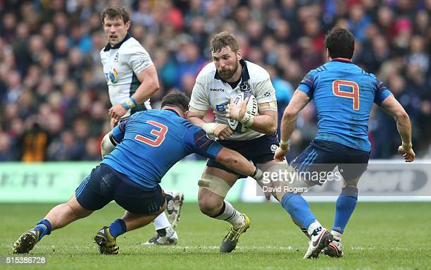 John Barclay of Scotland is tackled by Rabah Slimani during the RBS Six Nations match between Scotland and France at Murrayfield Stadium on March 13...
