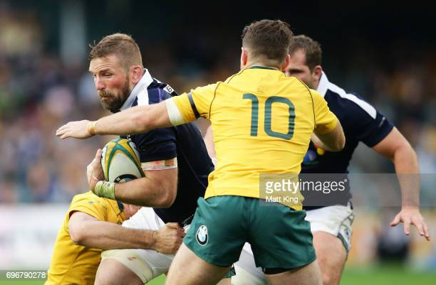 John Barclay of Scotland is tackled during the International Test match between the Australian Wallabies and Scotland at Allianz Stadium on June 17...
