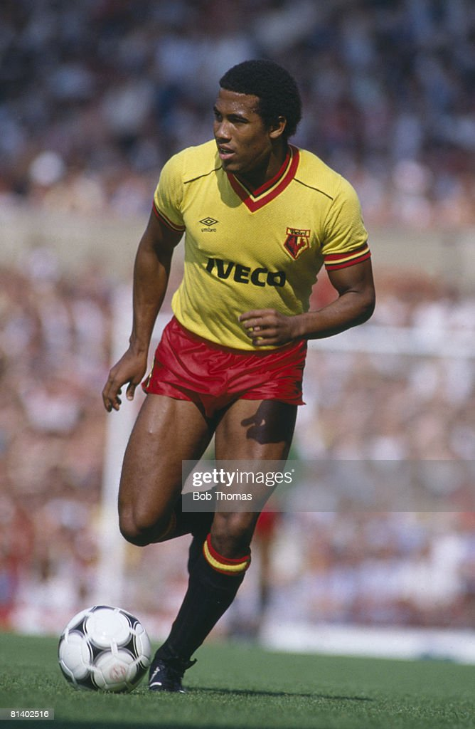 John Barnes in action for Watford against Manchester United during their 1st Division match at Old Trafford, 25th August 1984. The match ended in a 1-1 draw.