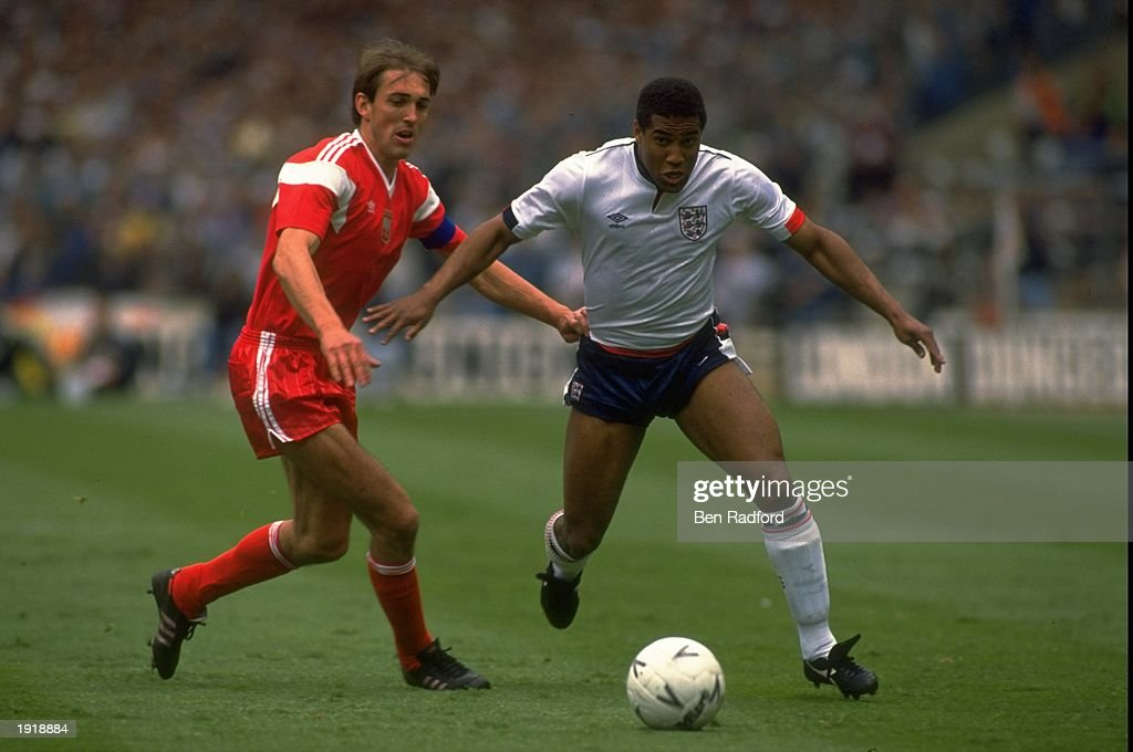 John Barnes (right) of England evades Prusik (left) of Poland during a World Cup Qualifying Group Two match at Wembley. England won the match 3-0. \ Mandatory Credit: Ben Radford/Allsport