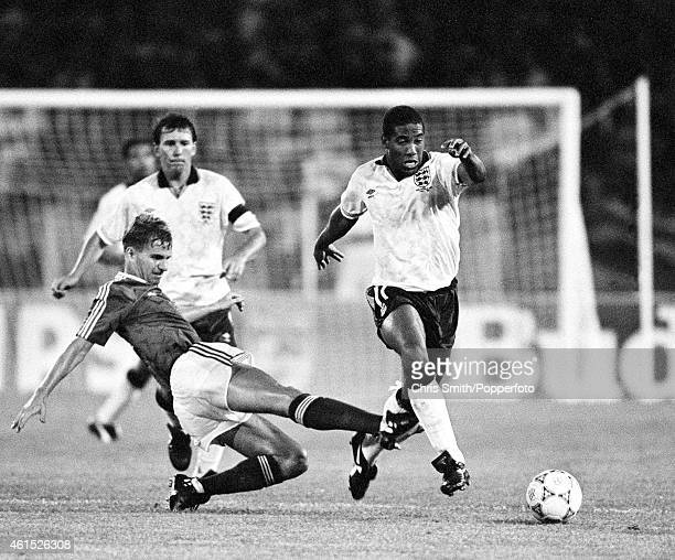 John Barnes of England evades Republic of Ireland defender Chris Morris with Bryan Robson looking on during the FIFA World Cup match between England...
