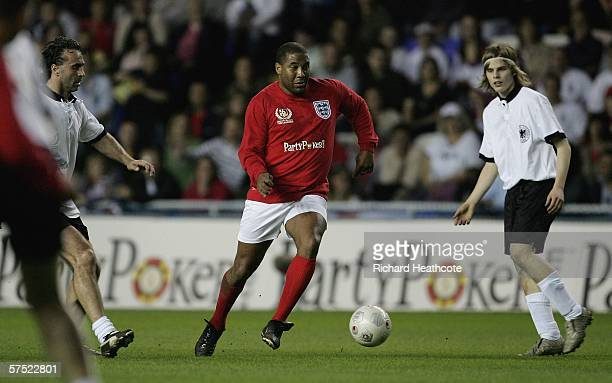 John Barnes of England jinks through the German defence during the Legends match between England and Germany at The Madejski Stadium on May 3 2006 in...