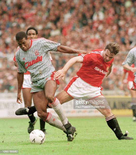 John Barnes of Liverpool and Brian McClair of Manchester United battle for the ball during the FA Charity Shield match between Liverpool and...
