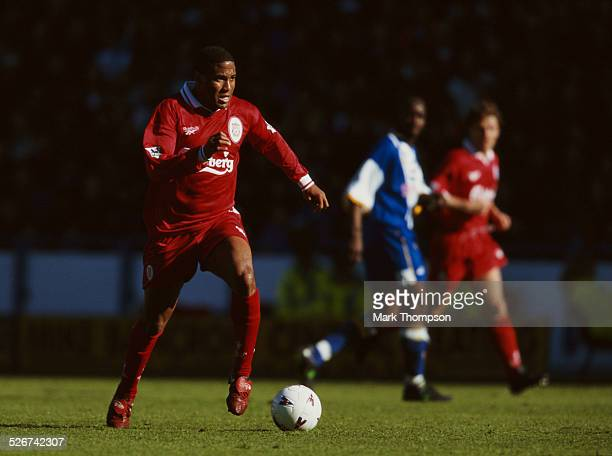 John Barnes of Liverpool FC wearing red boots during a Premier League match against Sheffield Wednesday on 11th May 1997 at Hillsborough Stadium,...