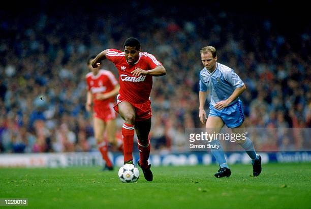 John Barnes of Liverpool gets away from David Speedie of Coventry City during the Division One match played at Anfield in Liverpool, England. The...