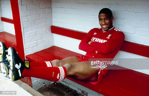 John Barnes poses in the home team dug out for an official photograph shortly after signing for Liverpool from Watford at Anfield on June 09 1987 in...