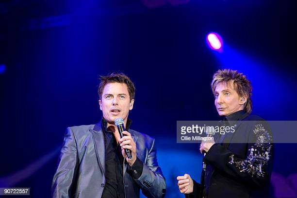 John Barrowman and Barry Manilow performing on stage as part of the BBC Proms In The Park at Hyde Park on September 12 2009 in London England