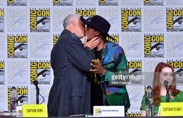 John Barrowman and Orlando Jones kiss onstage at The Great Debate panel hosted by SYFY WIRE during ComicCon International 2018 at San Diego...