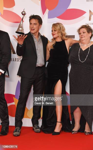 John Barrowman Emily Atack and Anne Hegerty accepting the Bruce Forsyth Award for Entertainment for I'm A CelebrityGet Me Out Of Here pose in the...