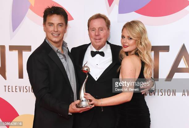 John Barrowman Harry Redknapp and Emily Atack accepting the Bruce Forsyth Award for Entertainment for I'm A CelebrityGet Me Out Of Here pose in the...