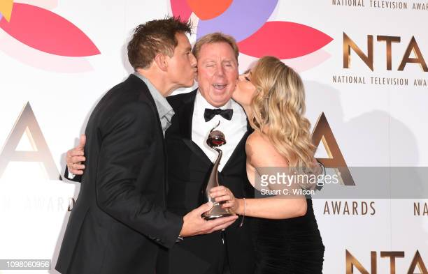 John Barrowman Harry Redknapp and Emily Atack with The Bruce Forsyth Entertainment Award for I'm A Celebrity… Get Me Out Of Here during the National...