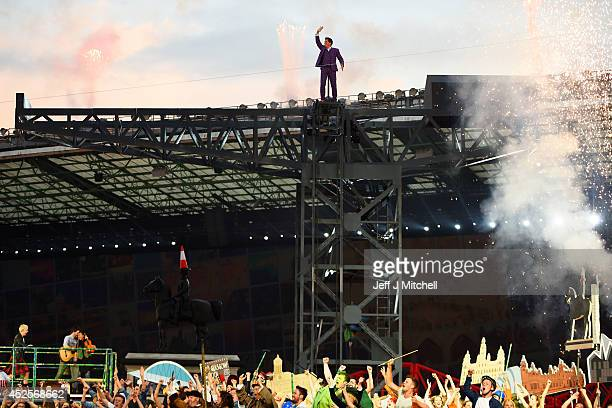 John Barrowman performs during the Opening Ceremony for the Glasgow 2014 Commonwealth Games at Celtic Park on July 23 2014 in Glasgow Scotland