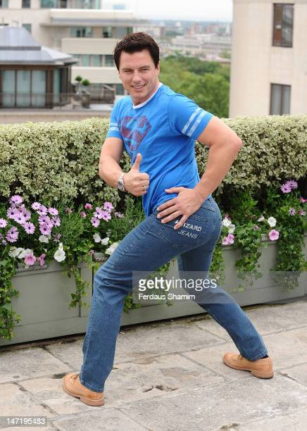 John Barrowman winner of Wizard Jeans Rear Of The Year Award 2012 attends a photocall at The Dorchester on June 27 2012 in London England
