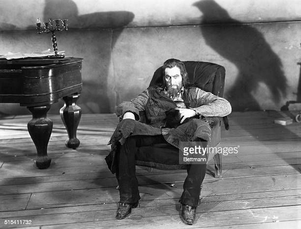 John Barrymore as Svengali the evil hypnotist seated in a haunted environment in a film still for the movie of the same name Barrymore wears a long...