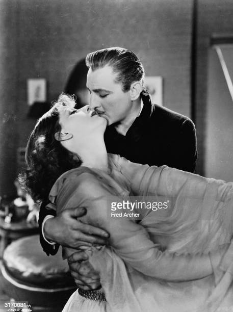 John Barrymore contrives to seduce the eccentric Greta Garbo in a scene from 'Grand Hotel' directed by Edmund Goulding for MGM