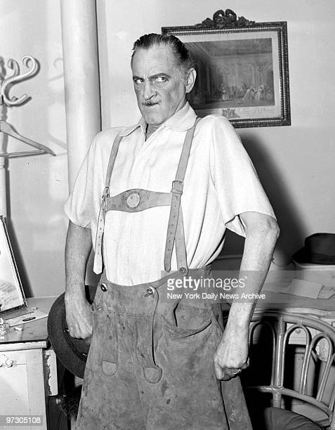 John Barrymore wearing lederhosen after sojouring in Mt Sinai Hospital strikes a pose to show he's fit as a fiddle at the Belasco Theater