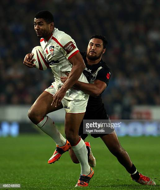 John Bateman of England tackled by Peta Hiku of New Zealand during the International Rugby League Test Series match between England and New Zealand...