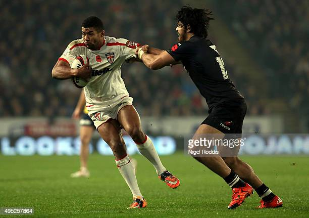 John Bateman of England tackled by Tohu Harris of New Zealand during the International Rugby League Test Series match between England and New Zealand...