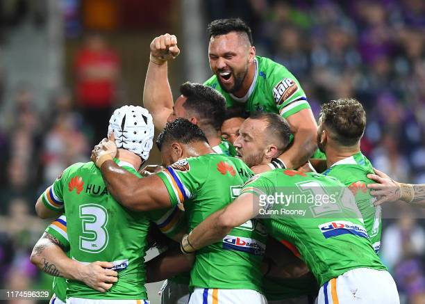 John Bateman of the Raiders is congratulated by team mates after scoring a try during the NRL Qualifying Final match between the Melbourne Storm and...