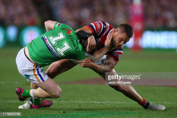 John Bateman of the Raiders is tackled by Jared Waerea-Hargreaves of the Roosters during the 2019 NRL Grand Final match between the Canberra Raiders...