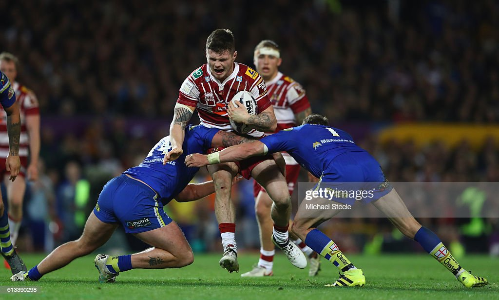 John Bateman (C) of Wigan cuts between Joe Westermam (L) and Kurt Gidley (R) of Warrington during the First Utility Super League Final between Warrington Wolves and Wigan Warriors at Old Trafford on October 8, 2016 in Manchester, England.
