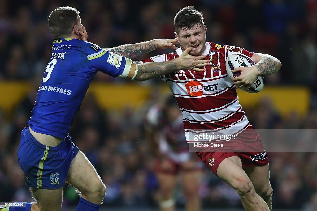 John Bateman (R) of Wigan feels the challenge from Daryl Clark of Warrington during the First Utility Super League Final between Warrington Wolves and Wigan Warriors at Old Trafford on October 8, 2016 in Manchester, England.