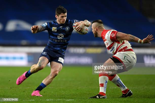 John Bateman of Wigan Warriors is tackled by Adam Sidlow of Leigh Centurions during the Betfred Super League match between Leigh Centurions and Wigan...
