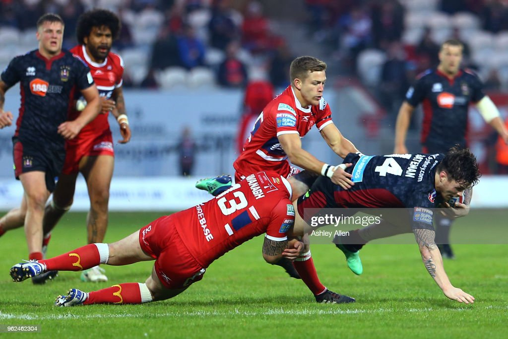 John Bateman of Wigan Warriors is tackled by Ben Kavanagh of Hull KR during the Betfred Super League at KCOM Craven Park on May 25, 2018 in Hull, England.