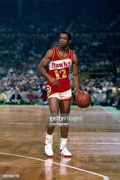 John Battle of the Atlanta Hawks handles the ball against the Boston Celtics during a game circa 1986 at the Boston Garden in Boston Massachusetts...