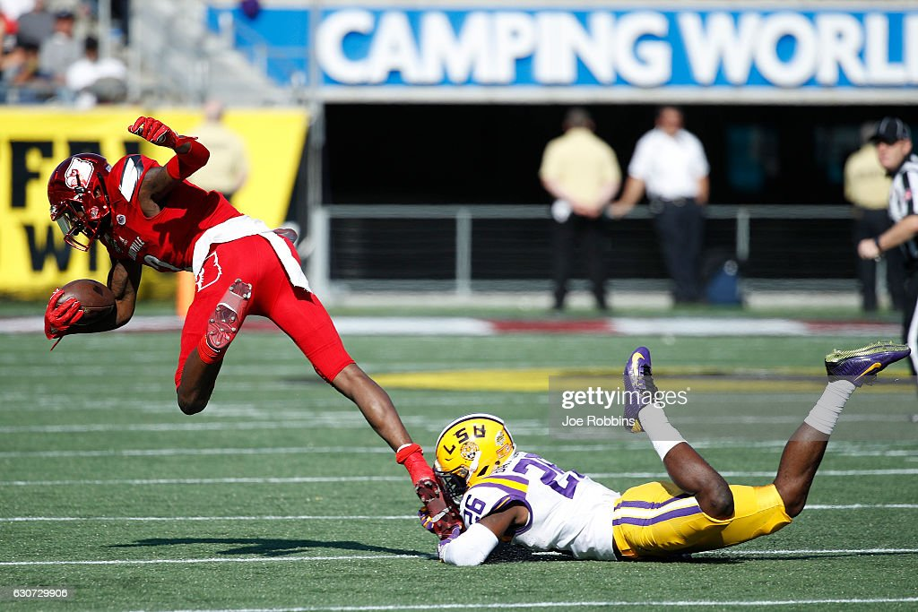 John Battle #26 of the LSU Tigers makes a shoestring tackle against Jamari Staples #2 of the Louisville Cardinals in the fourth quarter of the Buffalo Wild Wings Citrus Bowl at Camping World Stadium on December 31, 2016 in Orlando, Florida. LSU defeated Louisville 29-9.