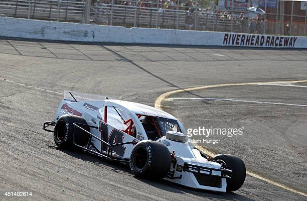 John Beatty Jr driver of the ElevatorEntrancecom Chevrolet drives during qualifying for the Hoosier Tire 200 at Riverhead Raceway on June 28 2014 in...