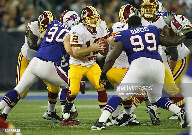 John Beck of the Washington Redskins is sacked during NFL game action by Chris Kelsay of the Buffalo Bills at Rogers Centre on October 30 2011 in...