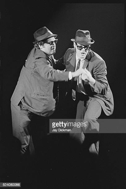 John Belushi and Dan Aykroyd dancing together as Jake and Elwood Blues during their Blues Brothers act