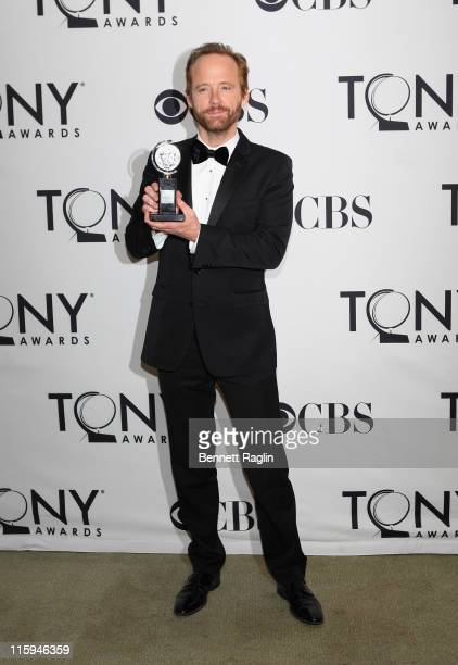 John Benjamin Hickey poses with the award for Best Performance by an Actor in a Featured role in a Play during the 65th Annual Tony Awards at the The...