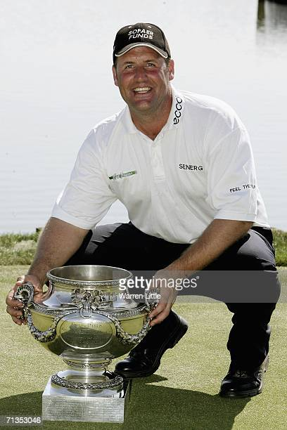 John Bickerton of England poses with the trophy after winning the 2006 Open de France presented by Alstom by one shot on a score of 11 under parat...