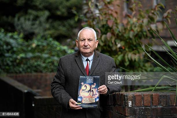 John Bird the founder of the Big Issue magazine holds a copy of this months Big Issue as he poses for a photograph outside the block of flats where...