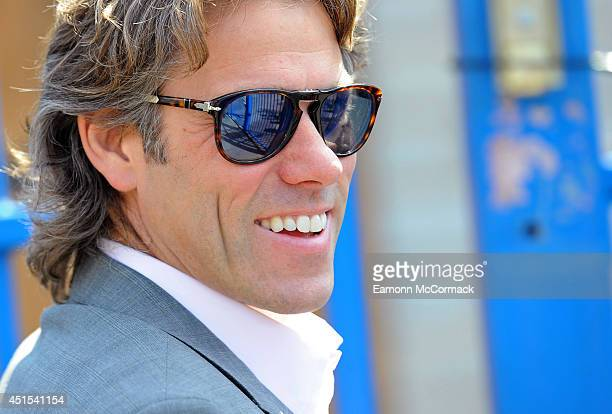 John Bishop arrives as The Duchess of Cambridge visits an MPACT Plus Counselling programme at Blessed Sacrament School on July 1 2014 in London...